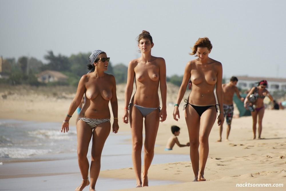 Young woman topless mono bikini sunbakes stock photo